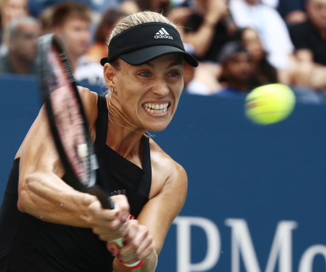 Angelique Kerber, of Germany, returns a shot to Dominika Cibulkova, of Slovakia, during the third round of the U.S. Open tennis tournament, Saturday, Sept. 1, 2018, in New York. (AP Photo/Andres Kudacki)