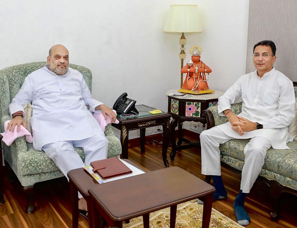 Former Congress leader Jitin Prasada meets Home Minister Amit Shah before joining the BJP, in New Delhi on Wednesday, 9 June.
