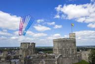 <p>The Red Arrows flying over Windsor Castle to mark the Queen's official birthday.</p>