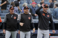 Baltimore Orioles manager Brandon Hyde (18), catching instructor Tim Cossins, center, and hitting coach Don Long, celebrate after the Orioles defeated the New York Yankees 5-3 in a baseball game, Saturday, March 30, 2019, in New York. (AP Photo/Julie Jacobson)