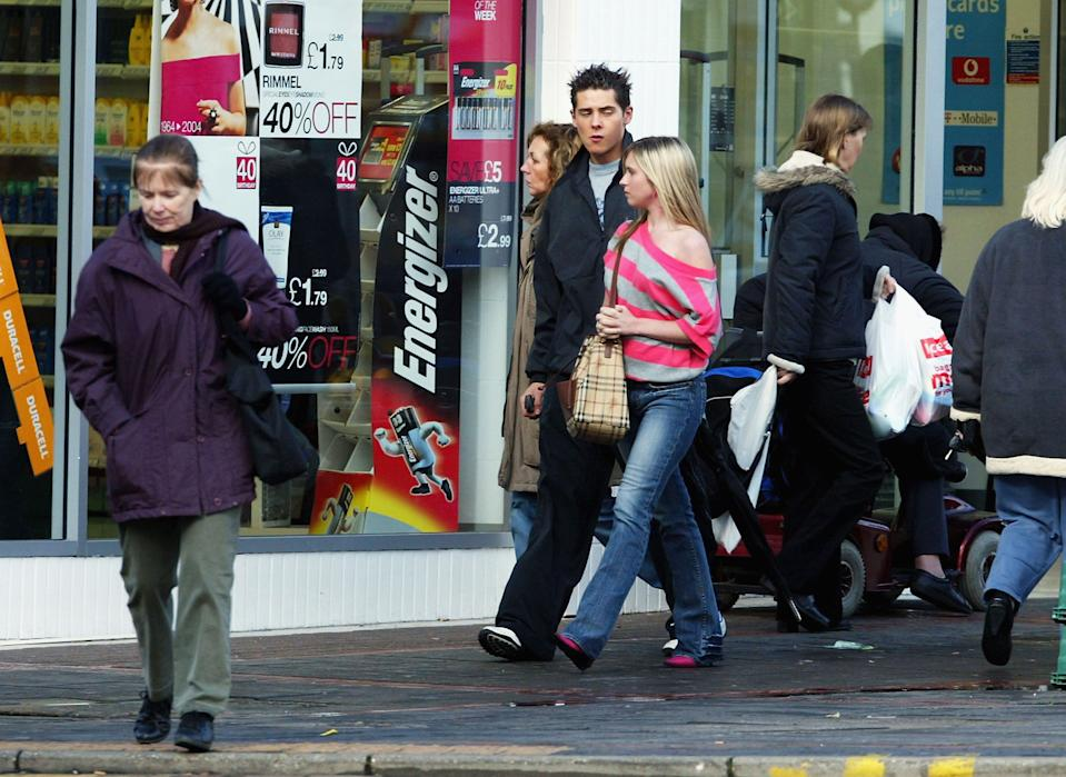 LONDON - MARCH 23: Christopher Parker and Brooke Kinsella seen out walking while taking a break from filming Eastenders March 23, 2004 in Elstree London. (Photo by Paul Ashby/Getty Images)