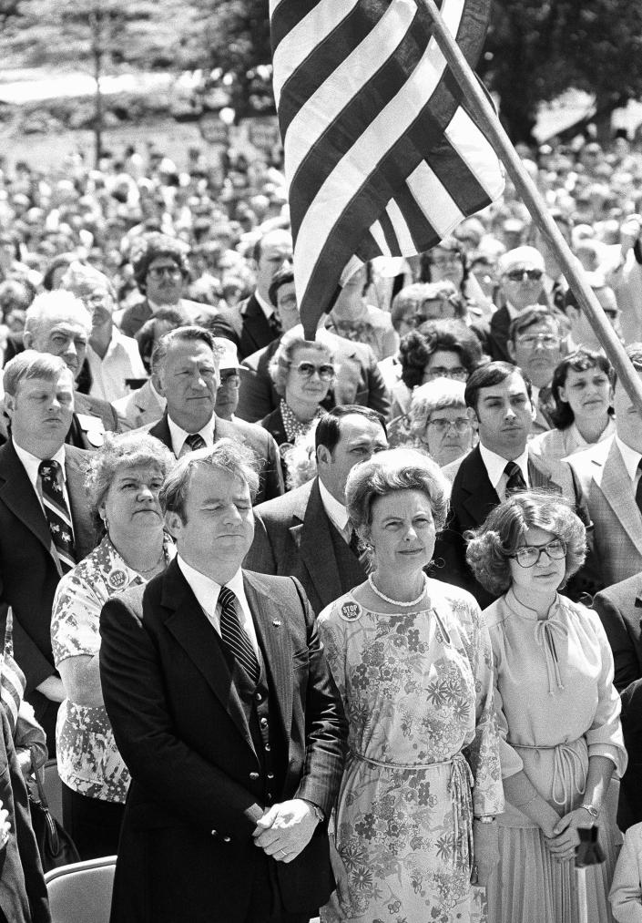 """Rev. Jerry Falwell Sr. and conservative activist Phyllis Schlafly during an """"I Love America"""" rally organized by Falwell in May 1980, in Springfield, Ill."""
