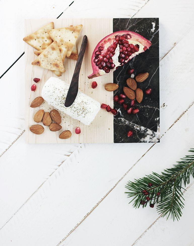 """<p>Though this charcuterie board looks like something you'd find at West Elm or Anthropologie, it comes at a fraction of the price—plus, it's so much more special, since it'll be handmade. </p><p><a href=""""https://themerrythought.com/diy/diy-marble-cutting-board/"""" rel=""""nofollow noopener"""" target=""""_blank"""" data-ylk=""""slk:Get the tutorial."""" class=""""link rapid-noclick-resp"""">Get the tutorial.</a></p><p><a class=""""link rapid-noclick-resp"""" href=""""https://www.amazon.com/Gorilla-Original-Waterproof-Polyurethane-Bottle/dp/B0000223UV?tag=syn-yahoo-20&ascsubtag=%5Bartid%7C10072.g.27603456%5Bsrc%7Cyahoo-us"""" rel=""""nofollow noopener"""" target=""""_blank"""" data-ylk=""""slk:SHOP GLUE"""">SHOP GLUE</a></p>"""