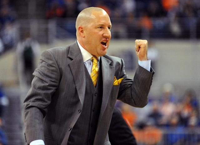 Coach Buzz Williams of the Marquette Golden Eagles directs play against the Florida Gators November 29, 2012 at Stephen C. O'Connell Center in Gainesville, Florida. Florida won 82 - 49. (Photo by Al Messerschmidt/Getty Images)