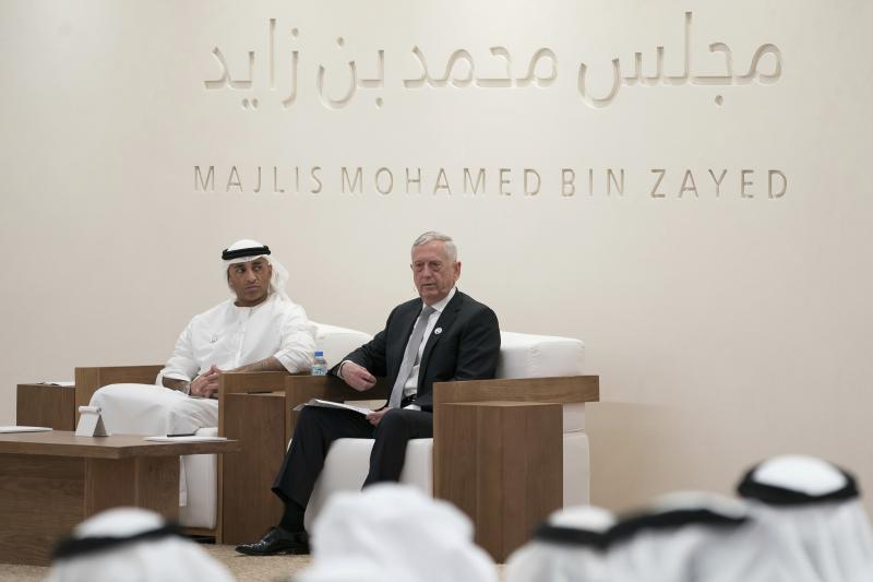 "In this Monday May 20, 2019 photo, Jim Mattis, former US Secretary of Defense, right, prepares to deliver a lecture ""The Value of the UAE - US Strategic Relationship"", at Majlis Mohamed bin Zayed, in Abu Dhabi, United Arab Emirates. Yousef Al Otaiba, UAE Ambassador to the U.S. and Mexico sits at left. Mattis told the audience that America ""needs to engage more in the world and intervene militarily less."" (Eissa Al Hammadi-Ministry of Presidential Affairs/WAM via AP)"