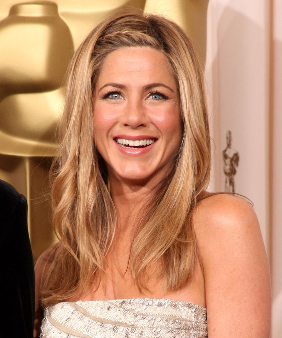 """<h3>2009: Braided Accent</h3><br>If Aniston's hairstyles have one thing in common, it's simplicity. This mini <a href=""""https://www.refinery29.com/en-us/french-braid-hairstyles"""" rel=""""nofollow noopener"""" target=""""_blank"""" data-ylk=""""slk:French braid"""" class=""""link rapid-noclick-resp"""">French braid</a> accent is a chic, subtly <a href=""""https://www.refinery29.com/en-us/romantic-hairstyles"""" rel=""""nofollow noopener"""" target=""""_blank"""" data-ylk=""""slk:romantic"""" class=""""link rapid-noclick-resp"""">romantic</a> accent to an otherwise low-key look at the 2009 Oscars.<span class=""""copyright"""">Photo: Jason Merritt/Getty Images.</span>"""