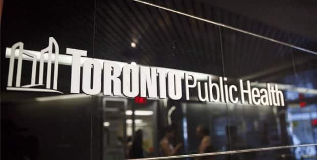In a number of tweets on the weekend, Toronto Public Health said two COVID-19 cases have surfaced at Elmlea Junior School, a junior kindergarten to grade five school in Toronto's Rexdale neighbourhood. TPH has declared an outbreak at the school. (Cole Burston/The Canadian Press - image credit)