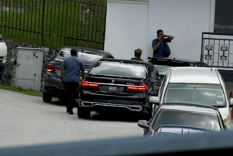 A BMW bearing the NH10 number plate, believed to be ferrying Nazri, is seen arriving at Najib's house on May 17, 2018. ― Picture by Mukhriz Hazim