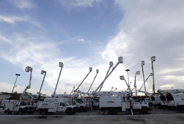 Utility trucks stage outside New Orleans as recovery efforts after Hurricane Isaac continue in New Orleans, Friday, Aug. 31, 2012. Isaac is now a tropical depression and the center was on track to cross Arkansas on Friday and southern Missouri on Friday night, spreading rain as it goes. (AP Photo/David J. Phillip)