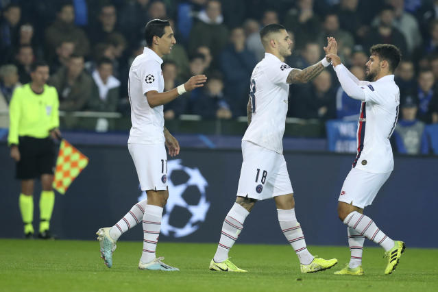 PSG's Mauro Icardi, center, is congratulated after scoring the opening goal of the match during a Champions League Group A soccer match between Club Brugge and Paris Saint Germain at the Jan Breydel stadium in Bruges, Belgium, Tuesday, Oct. 22, 2019. (AP Photo/Francisco Seco)