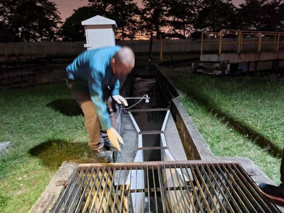 Personnel collecting samples from a residential area storm drain, during the department's investigation into the cause of the dead fishes along Sungai Damansara. — Picture courtesy of Selangor Department of Environment