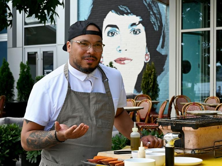 """Grant, pictured outside his restaurant, Jackie, recalls being told his skills were """"pretty good for a Black chef"""""""