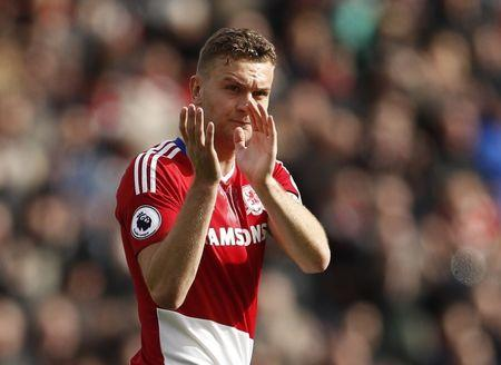 Middlesbrough's Ben Gibson applauds fans after the game