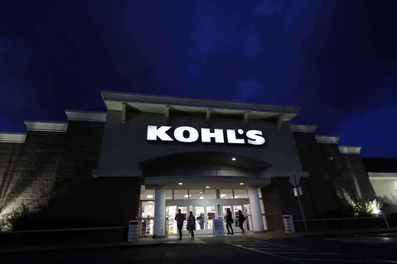 Customers walk outside of a Kohl's store in Colma, Calif., Friday, Nov. 29, 2019. Black Friday once again kicked off the start of the holiday shopping season. (AP Photo/Jeff Chiu)
