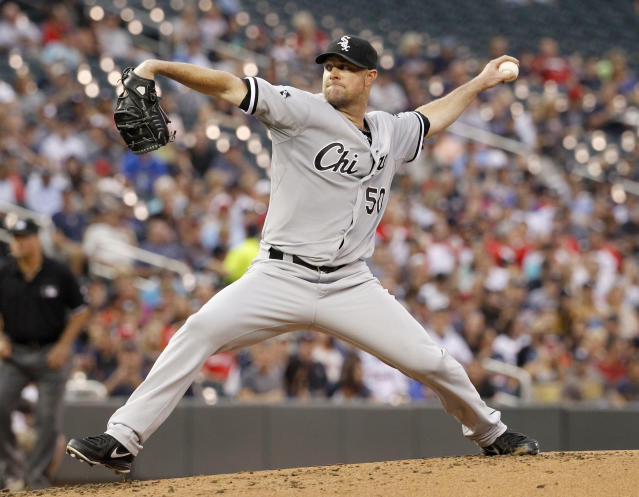 Chicago White Sox starting pitcher John Danks delivers to the Minnesota Twins during the first inning of a baseball game in Minneapolis, Friday, July 25, 2014. (AP Photo/Ann Heisenfelt)