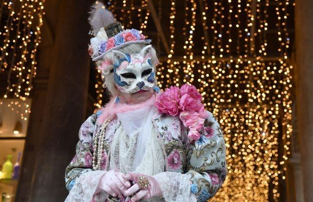 """The """"Gnaga"""" is a traditional Venetian cat mask often worn by carnival-goers. It is typically worn with women's clothing"""