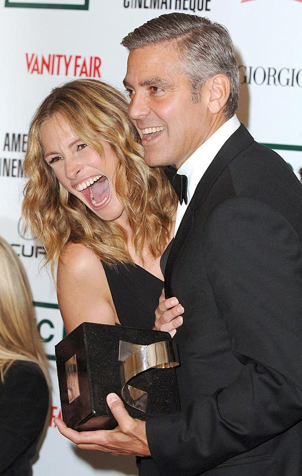 "Half the fun of watching ""Ocean's Eleven"" was seeing two of the world's biggest stars play a couple. Off-screen, however, Julia Roberts and George Clooney are just very good friends ... with incredible chemistry! SGranitz/<a href=""http://www.wireimage.com"" target=""new"">WireImage.com</a> - October 14, 2006"