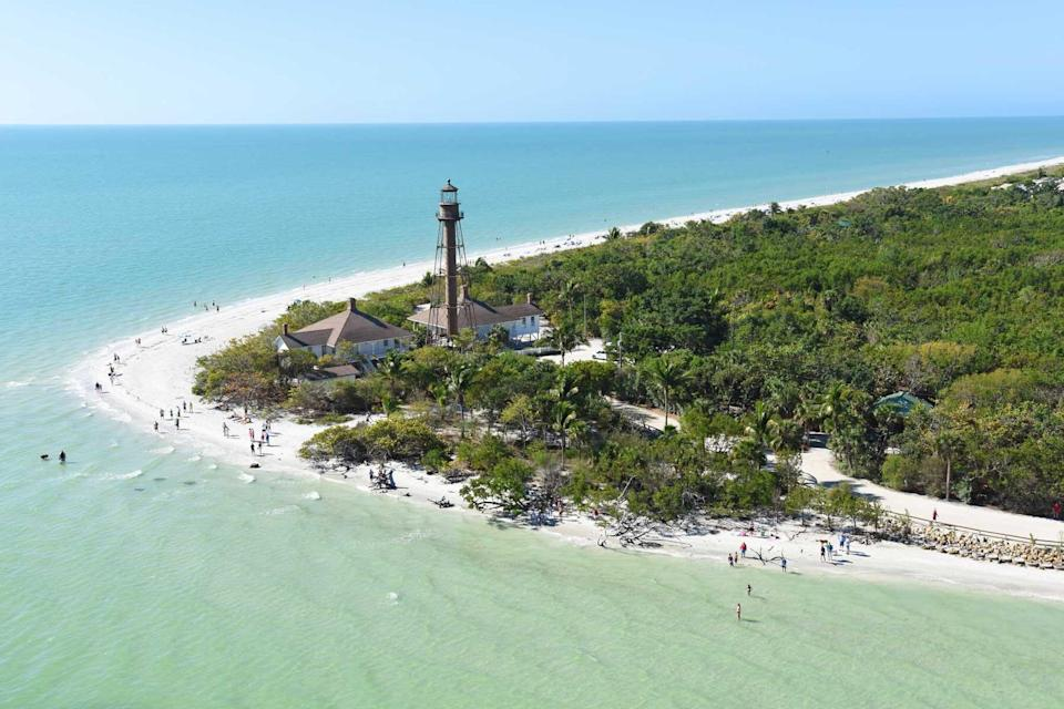Aerial view of the lighthouse and clear waters off the coast of Sanibel Island, Florida