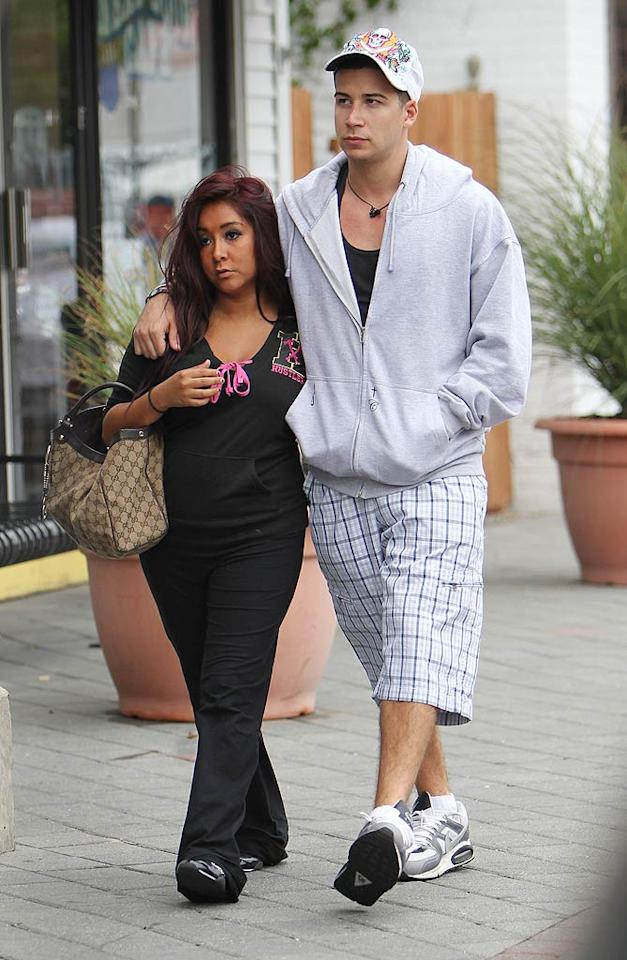 """Snoooki also got to know her other roomie, Vinny Guadagnino, quite well in the bedroom on Season 2. While Vinny claimed that it didn't make things awkward between them, Snooki confessed on SiriusXM's Morning Mash Up that she was a little embarrassed. """"I kind of wish me and Vinny didn't try and have sex because it was just drama this whole season,"""" she explained. """"And I don't know, it was just awkward between us and then I felt stupid … it's just embarrassing."""" Making matters worse? Snooki admitted she """"kind of got feelings"""" for Vin, who continued to hook up with other girls right under her nose. """"He tells me he's not going to bring anyone else back home so we can cuddle, and then he brings somebody home,"""" she whined. """"It just makes me look stupid."""" Indeed. Brian Prahl/Ryan Turgeon/<a href=""""http://www.splashnewsonline.com"""" target=""""new"""">Splash News</a> - August 18, 2010"""