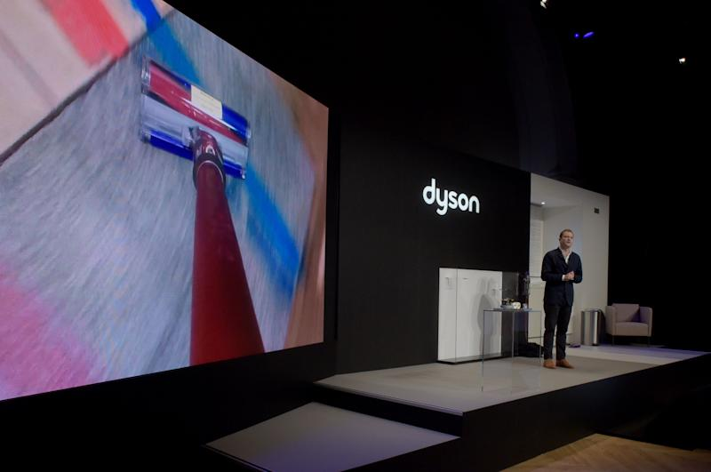 British inventor James Dyson's son Jake Dyson, Chief engineer at Dyson presents the company's new model of vacuum cleaner in Paris on March 6, 2018. / AFP PHOTO / ERIC PIERMONT (Photo credit should read ERIC PIERMONT/AFP/Getty Images)