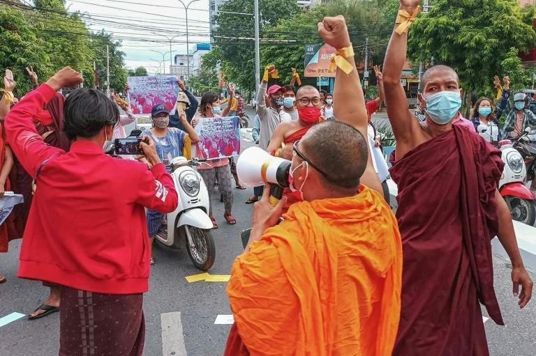 Dozens of monks in their bright orange and crimson robes marched through the streets of Mandalay (AFP/STR)