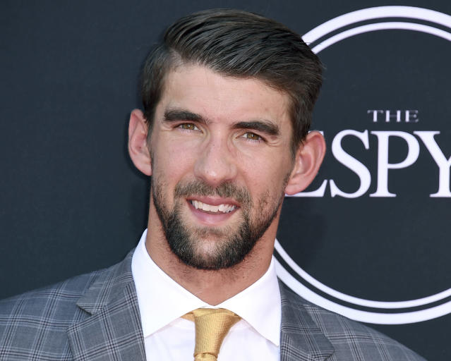 FILE - In this July 12, 2017, file photo, Michael Phelps arrives at the ESPYS in Los Angeles. While swimming to Olympic glory, Phelps found comfort in the pool and quite a bit of angst out of it. Because he is willing to share his story of depression and raise awareness of mental health issues, Phelps will be awarded the fifth annual Morton E. Ruderman Award in Inclusion on Tuesday night, May 21, 2019, in Boston. (Photo by Jordan Strauss/Invision/AP, File)