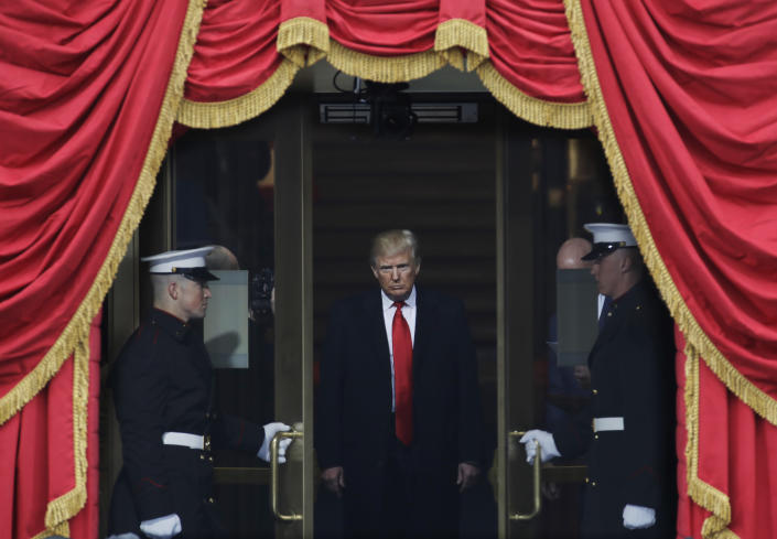 President-elect Donald Trump steps out to the portico to be sworn in as 45th president of the United States during the 58th Presidential Inauguration at the U.S. Capitol in Washington, Friday, Jan. 20, 2017. (AP Photo/Patrick Semansky)