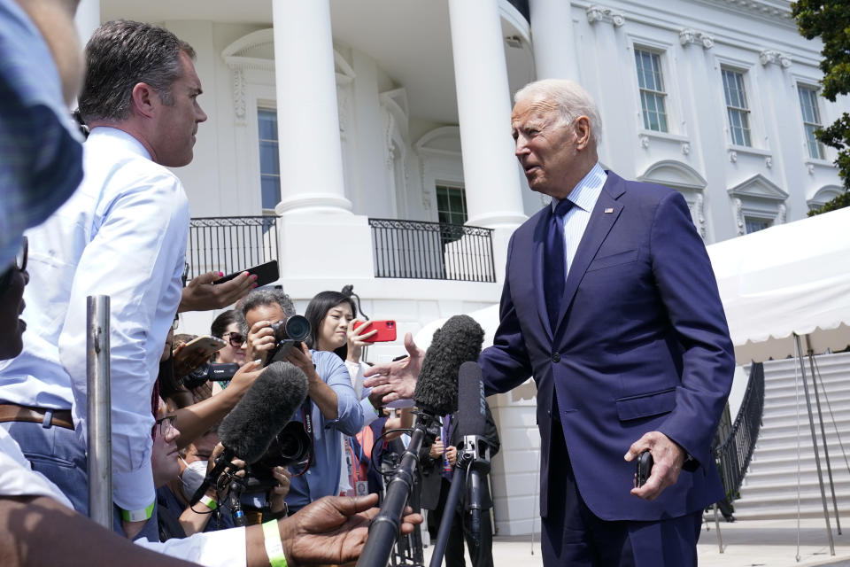 President Joe Biden briefly talks with reporters as he heads to Marine One on the South Lawn of the White House in Washington, Friday, July 16, 2021, to spend the weekend at Camp David. (AP Photo/Susan Walsh)