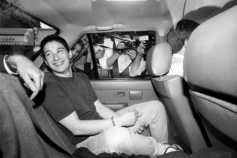 Adam Horovitz, a member of the American rap group, The Beastie Boys, is driven away from Notting Hill police station, London, after being arrested in the wake of last night's concert in Liverpool. The gig ended in chaos after fighting erupted among the audience.