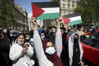 Protesters hold placards depicting the Palestinian flag in Paris, Saturday, May 22, 2021, as they take part in a rally supporting Palestinians. Egyptian mediators held talks Saturday to firm up an Israel-Hamas cease-fire as Palestinians in the Hamas-ruled Gaza Strip began to assess the damage from 11 days of intense Israeli bombardment.Supporters of the Palestinians. (AP Photo/Thibault Camus)