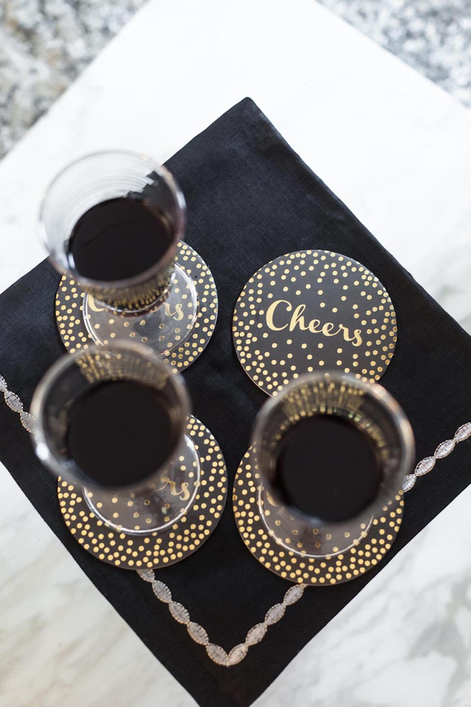 """<p>Aiming to evoke a classic Kate Spade vibe at your party? A clean black palette speckled with shimmery gold dots and bouncy calligraphy is your recipe for success, as proven by this vignette from <a rel=""""nofollow noopener"""" href=""""http://fashionablehostess.com/"""" target=""""_blank"""" data-ylk=""""slk:Fashionable Hostess"""" class=""""link rapid-noclick-resp"""">Fashionable Hostess</a>. </p>"""