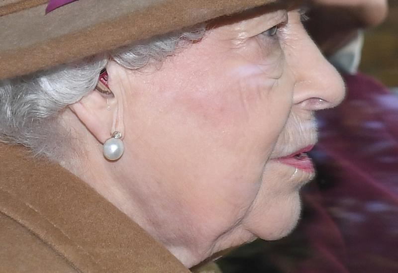 A hearing aid is visible as the Queen Elizabeth II arrives to attend a morning church service at St Mary Magdalene Church in Sandringham, Norfolk. PA Photo. Picture date: Sunday January 12, 2020. Photo credit should read: Joe Giddens/PA Wire