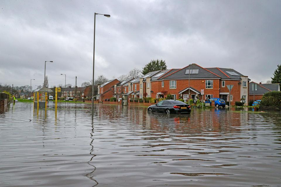 Flooded roads in West Derby, Liverpool (Peter Byrne/PA) (PA Archive)