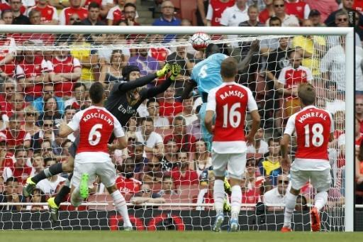 Petr Cech is left stranded as Cheikhou Kouyate heads in West Ham's opening goal. Pic: AP