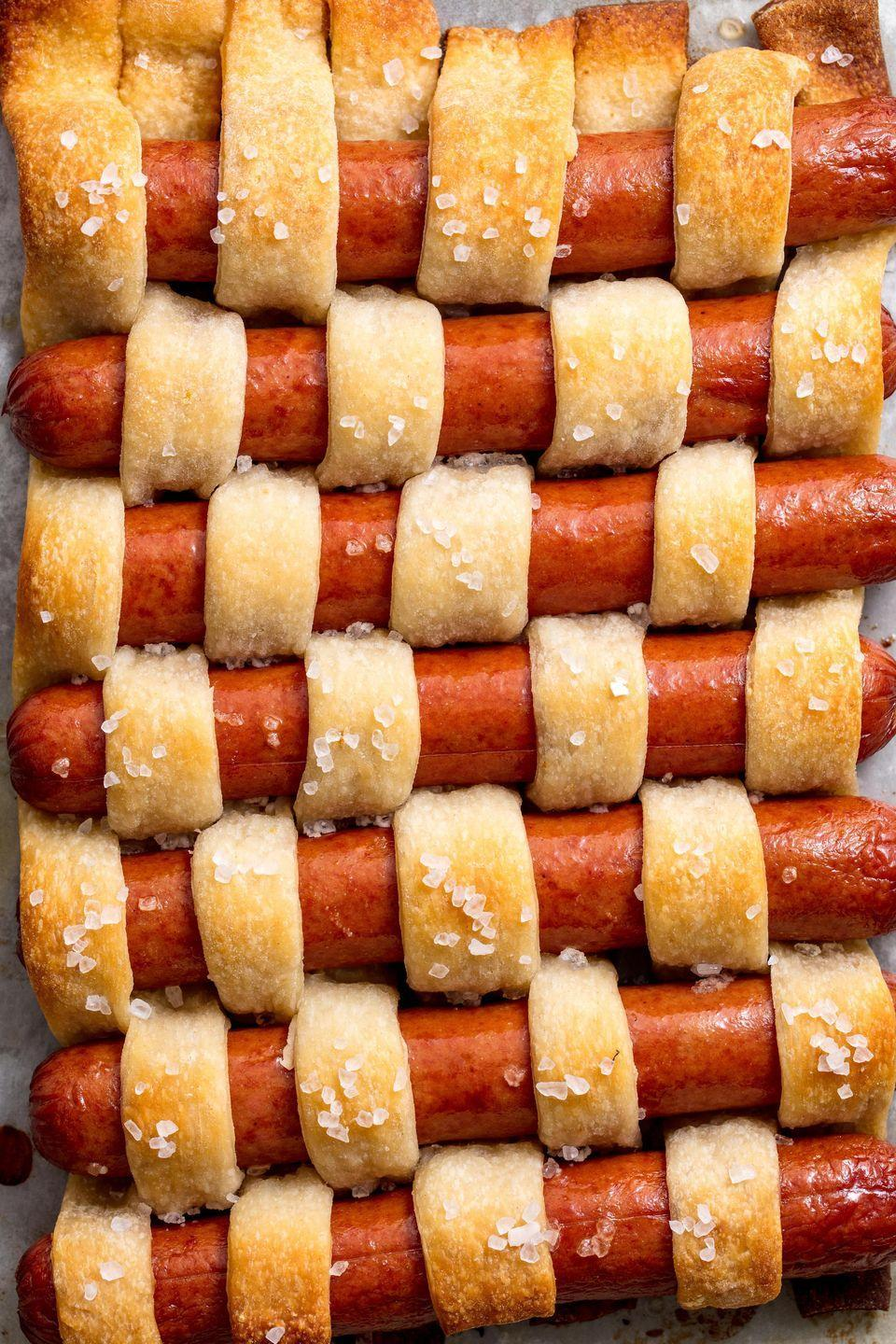 """<p>This is basically hot dog art.</p><p>Get the recipe from <a href=""""/cooking/recipe-ideas/recipes/a47591/pigs-in-a-quilt-recipe/"""" data-ylk=""""slk:Delish"""" class=""""link rapid-noclick-resp"""">Delish</a>.</p>"""