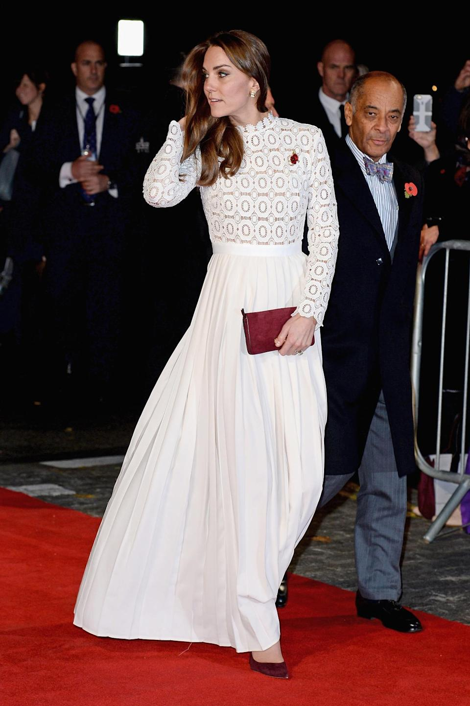 <p>At the 'Street Cat Named Bob' premiere, the Duchess turned heads in her first Self Portrait dress - the cult contemporary label that's secured a place in almost every celebrity's wardrobe over the past few years. The floor-sweeping number boasts a lace bodice and a thigh-high slit. </p><p><i>[Photo: Getty]</i></p>
