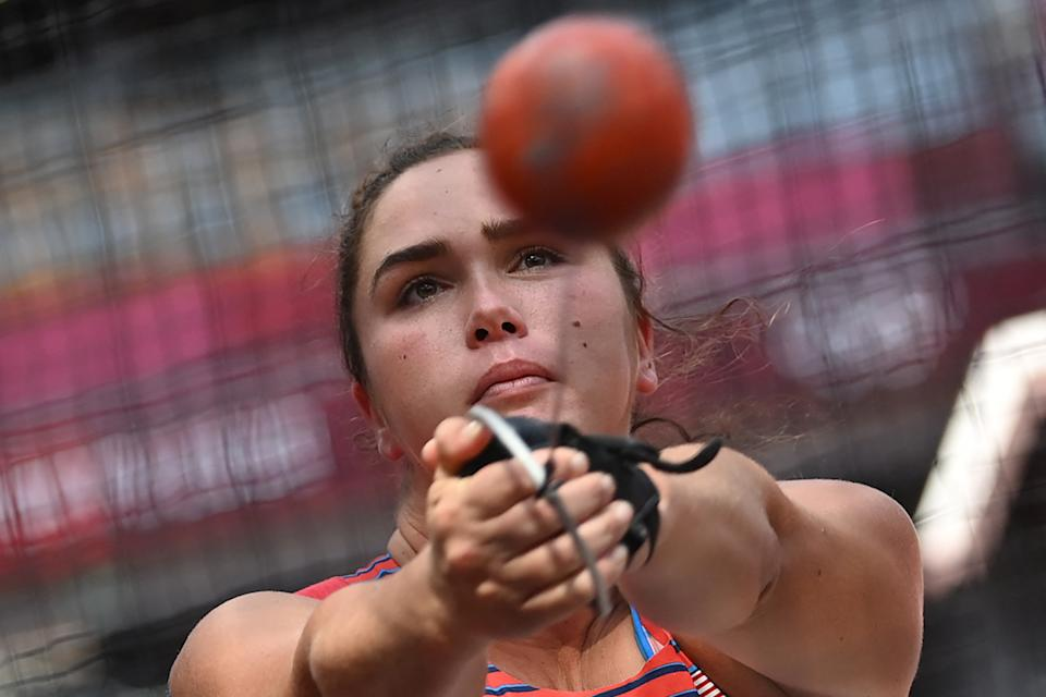 <p>USA's Brooke Andersen competes in the women's hammer throw qualification during the Tokyo 2020 Olympic Games at the Olympic Stadium in Tokyo on August 1, 2021. (Photo by Andrej ISAKOVIC / AFP)</p>