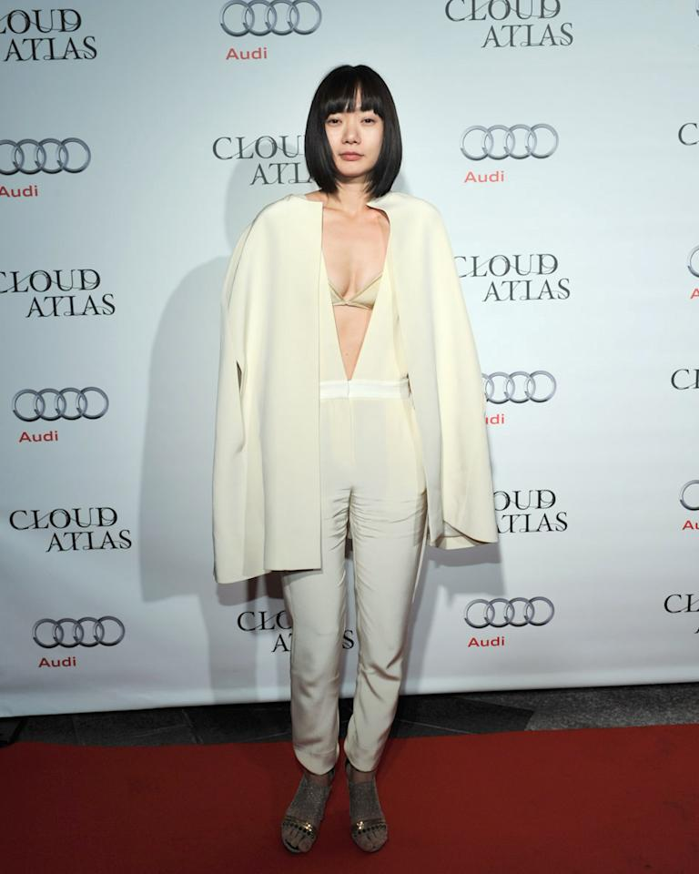 """WORST: South Korean actress Doona Bae is just now being introduced to English-speaking audience through her new role in the upcoming film """"Cloud Atlas."""" Too bad she chose this outfit to make her grand debut. The ensemble is at once too revealing (cover up that ugly bra, missy!) and too baggy (what's up with that shawl?)."""