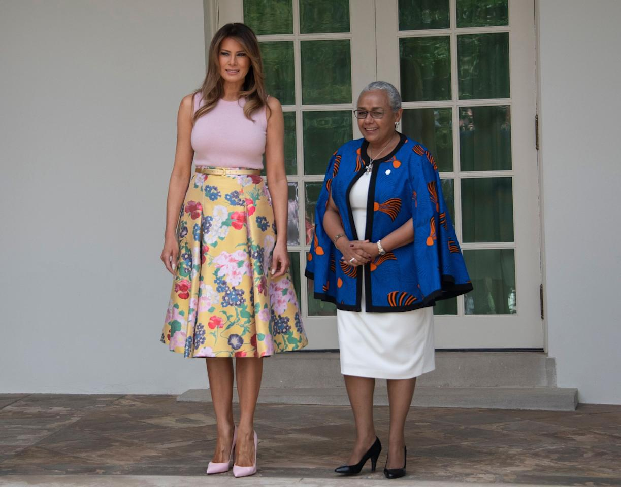 <p>Melania Trump stood next to the wife of President Uhuru Kenyatta of the Republic of Kenya, Mrs. Margaret Kenyatta, as the FLOTUS welcomed the leaders to the White House with her husband. For the occassion, she wore a £3,100 Valentino skirt and four-inch Louboutin heels. This outfit choice was amusing to some, especially as part of the days activities included a spot of gardening on the White House lawn.<br /><em>[Photo: Rex]</em> </p>