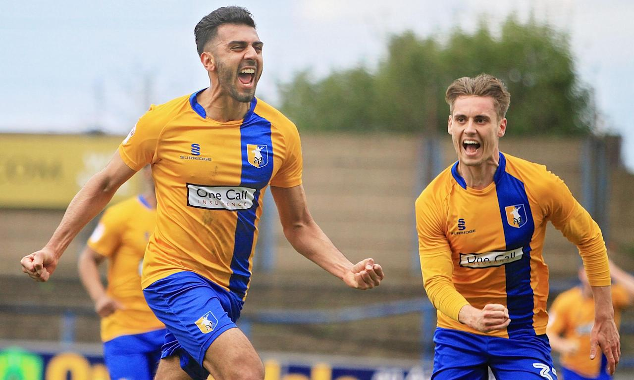 Mansfield Town, whose defender Malvind Benning, left, is here celebrating a goal against Exeter last season, look well placed to challenge for the title.
