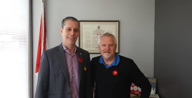 Ian Andexser (right) of Nanaimo, B.C. with Green MP Paul Manly.