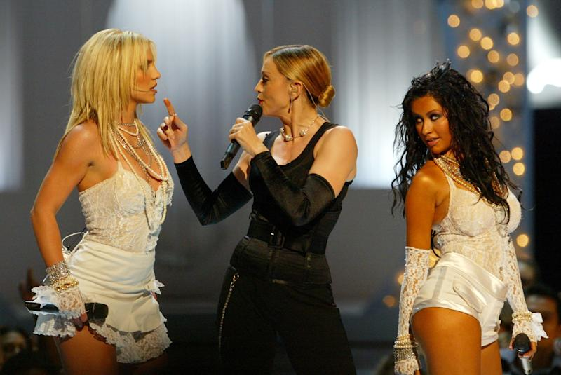 Britney Spears, Madonna and Christina Aguilera perform opening act at the 2003 MTV Video Music Awards (Photo by Kevin Kane/WireImage)