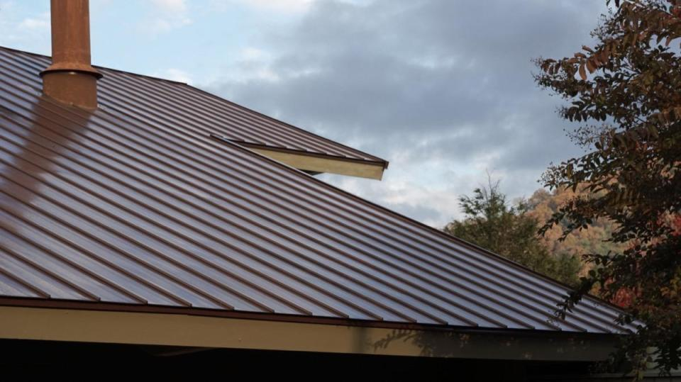 """In addition to being time-consuming and requiring special skills, installing metal roofing may also warrant specialized tools, meaning it's best to leave this job to the experts. """"I have countless times been contacted by homeowners who purchased metal roofing materials, started the job, and decided they were in way over their heads and needed professional help,"""" says <strong>Todd Miller</strong>, president of <a href=""""https://www.isaiahindustries.com/"""" rel=""""nofollow noopener"""" target=""""_blank"""" data-ylk=""""slk:Isaiah Industries"""" class=""""link rapid-noclick-resp"""">Isaiah Industries</a>, a manufacturer of metal roofing materials. Miller adds that there can be confusion as to what needs to be ordered, """"making you vulnerable to expensive small orders to finish up the project."""" If you are intent on doing it yourself, remain in close consultation with your local supplier, who can serve as a guide. """"Even then, expect a lot of hours of very hard work,"""" Miller says."""