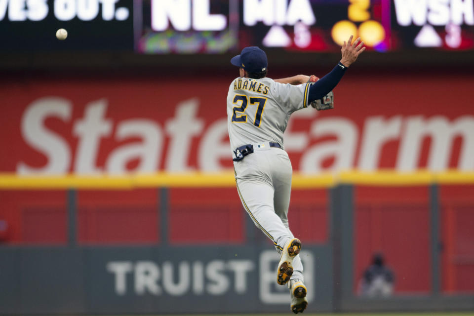 Milwaukee Brewers' Willy Adames misses an infield pop fly during the second inning of a baseball game against the Atlanta Braves, Saturday, July 31, 2021, in Atlanta. (AP Photo/Hakim Wright Sr.)