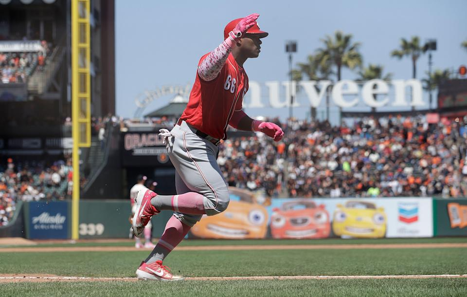 Cincinnati Reds' Yasiel Puig celebrates after hitting a solo home run against the San Francisco Giants during the sixth inning of a baseball game in San Francisco, Sunday, May 12, 2019. (AP Photo/Jeff Chiu)