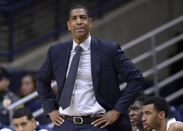 FILE - In this Feb. 7, 2018, file photo, Connecticut head coach Kevin Ollie watches from the sideline during the first half an NCAA college basketball game in Storrs, Conn. Ollie was fired in March amid an NCAA investigation. In response to open records requests from The Associated Press and other news organizations, UConn president Susan Herbst on Monday, June 25, released a June 19 letter upholding Ollie's firing, which said the former men's basketball coach had a pattern of breaking NCAA rules and committed serious violations. (AP Photo/Jessica Hill, File)