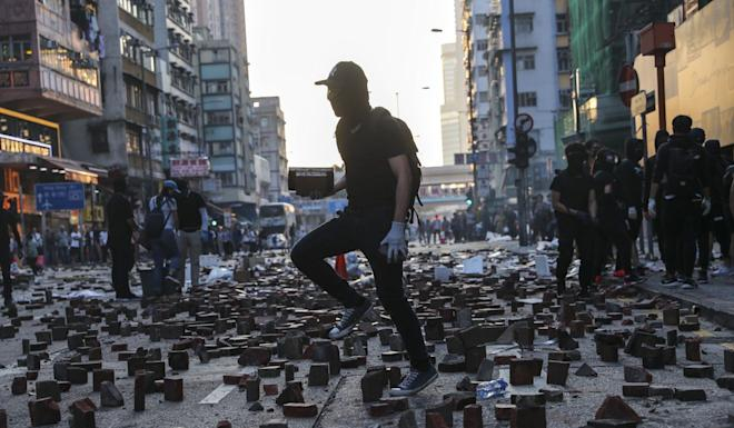 Protesters fill the streets with bricks in Mong Kok on Monday. Photo: Sam Tsang