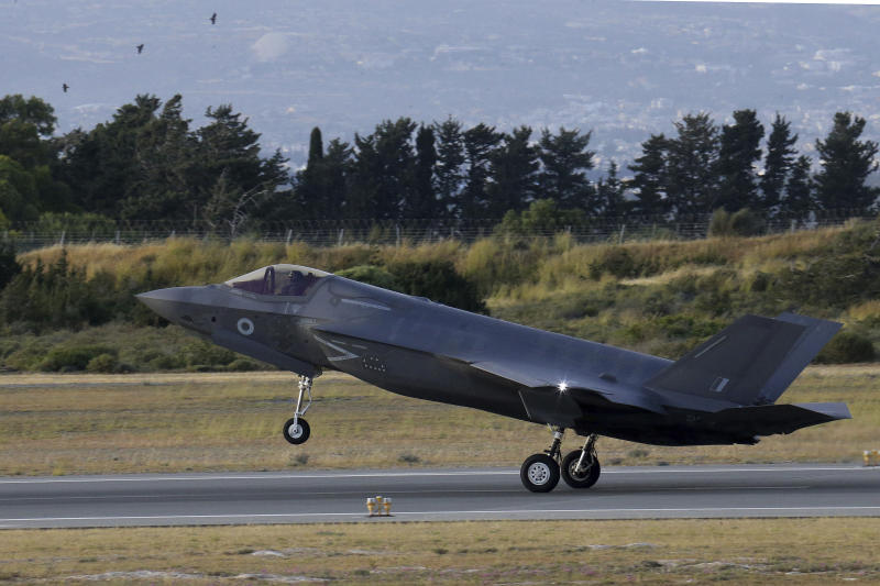 FILE - In this Tuesday, May 21, 2019 file photo, a F-35B aircraft lands at Akrotiri Royal air forces base near coastal city of Limassol, Cyprus. Britain's defense secretary said the country's most advanced military aircraft, the Lightning F-35B, that is undergoing training at a British air base in Cyprus has flown its first missions over Syria and Iraq as part of the ongoing operations against the Islamic State group, in a statement issued Tuesday June 25, 2019. (AP Photo/Petros Karadjias, File)
