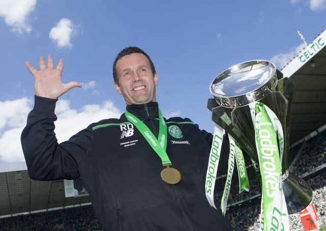 Ronny Deila with the Premiership trophy after a 7-0 win over Motherwell in his last game (Danny Lawson/PA)