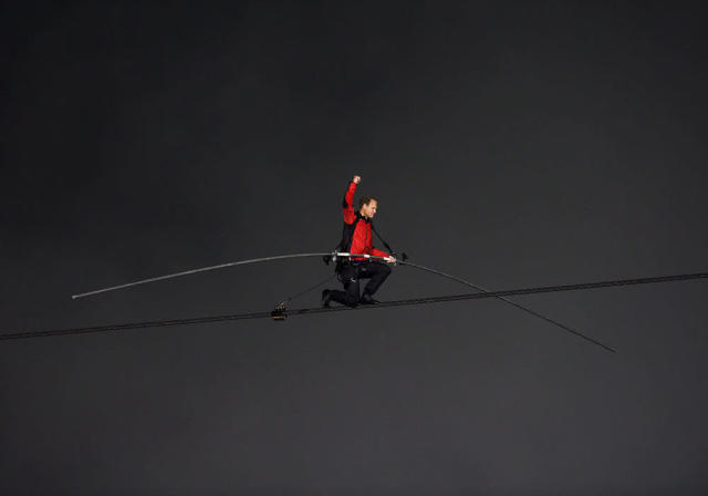 Nik Wallenda pumps his fist on one knee as he nears completion of his 1,800 feet-long tightrope walk over the brink of the Niagara Falls in Niagara Falls, Ont., on Friday, June 15, 2012. Wallenda battled brisk winds and thick mist Friday to make history, becoming the first person to walk across Niagara Falls on a tightrope. (AP Photo/The Canadian Press, Aaron Vincent Elkaim)